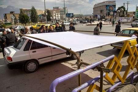 وزش باد شدید برای تبلیغات نامزدها در استان کرمانشاه دردسرساز شد