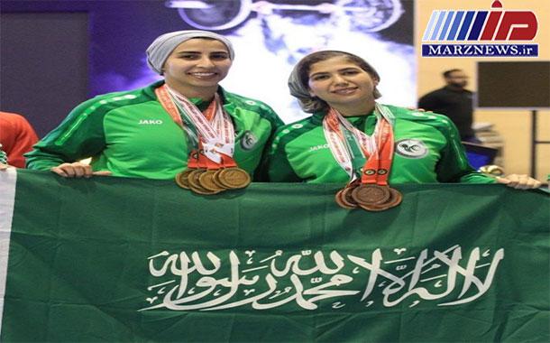 اولين حضور زنان عربستان دررقابت وزنه برداري +عكس